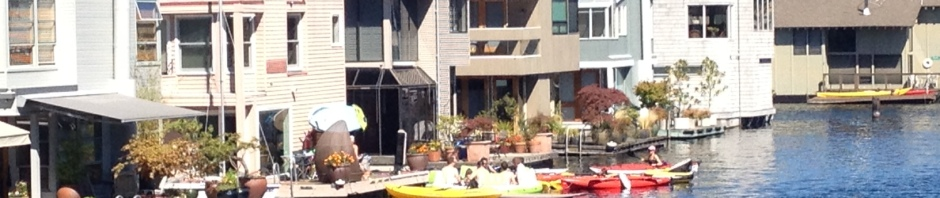 Photo of Flotilla of kayakers tied up at a Floating Home in Eastlake on Lake Union in Seattle.
