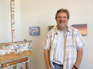 Artist Fred Lisaius in his Art Studio, in front of a few of his smaller paintings