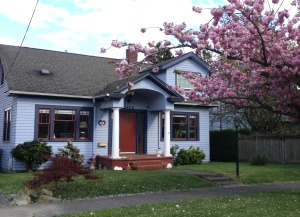 Cute West Seattle home with blooming cherry tree. Art of Real Estate